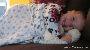 Snuggling with his blanket and critters!