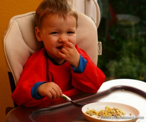 Enjoying his cheesy eggs!